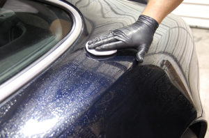 Auto detailing begins with a thorough washing of a car surface.