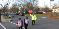 One basic back to school safety tips is to follow a crossing guard's lead.