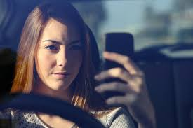 If you want a distracted driving ticket asap, take a selfie of yourself in motion.