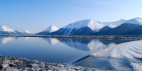 A trip along Seward highway offers travellers sights of impressive mountain ranges.