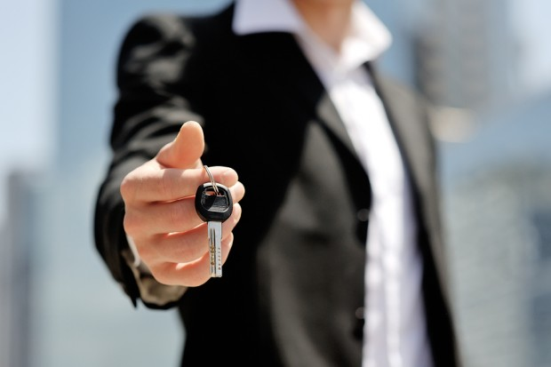 person holding a car key