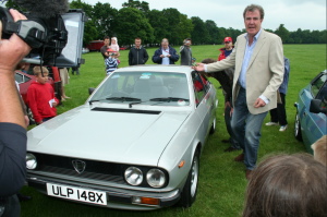 Jeremy Clarkson next to a Beta Coupe in Stanford Hall
