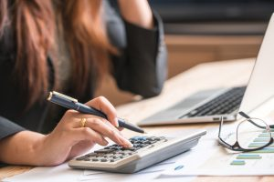 Woman calculating interest rate on bad credit car loan in toronto