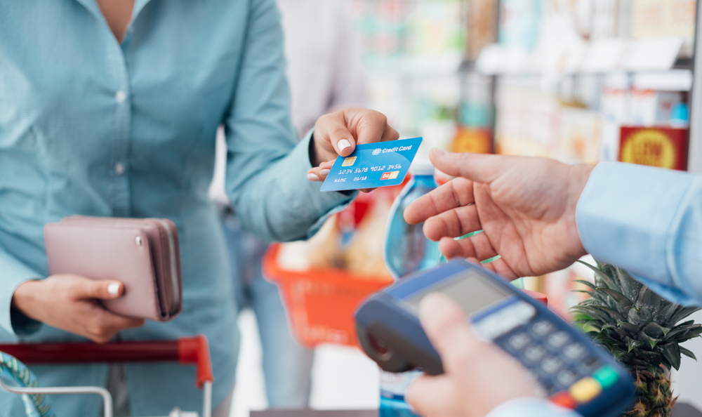 Woman building credit history by shopping with credit card.